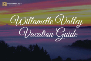 """view of valley with words """"willamette valley vacation guide"""" on top"""